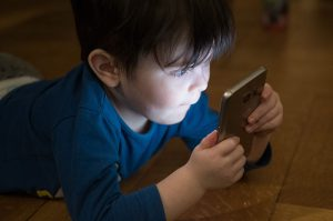Child looking at phone